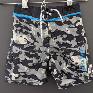 OshKosh B'gosh camo type print swim trunks